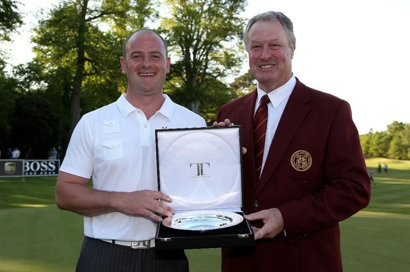 VIRGINIA WATER, ENGLAND - MAY 23:  Craig Lee of Scotland receives the Silver Salver for top PGA Pro at the end of the final round of the BMW PGA Championship on the West Course at Wentworth on May 23, 2010 in Virginia Water, England.  (Photo by Andrew Redington/Getty Images)