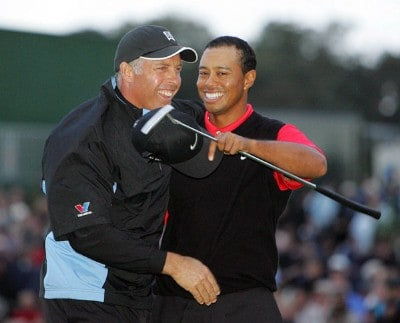 No UK & Germany rights,  Tiger Woods celebrates victory with caddie Steve Williams  during the final round of the 2006 WGC American Express Championship held at the Grove Golf Club in Watford, on October 1, 2006.Photo by FotoSports/WireImage.com