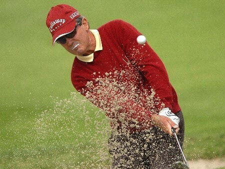 Mark McNulty hits out of a bunker on the fifth hole during the second round of the Champions' Tour 2005 Toshiba Senior Classic at  the Newport Beach Country Club in Newport Beach, California March 19, 2005.