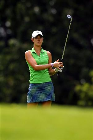 KUALA LUMPUR, MALAYSIA - OCTOBER 21:  Michelle Wie of USA watches her 2nd shot on the 9th hole during the Sime Darby Pro-Am at the KLGCC Golf Course on October 21, 2010 in Kuala Lumpur, Malaysia.  (Photo by Stanley Chou/Getty Images)