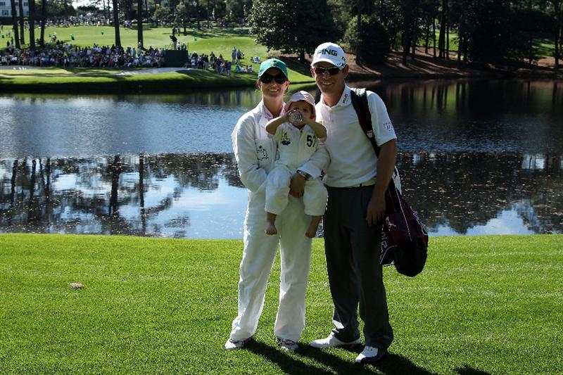 AUGUSTA, GA - APRIL 06:  Louis Oosthuizen of South Africa and his wife Nel-Mare and daughter Jana pose for a photo during the Par 3 Contest prior to the 2011 Masters Tournament at Augusta National Golf Club on April 6, 2011 in Augusta, Georgia.  (Photo by Andrew Redington/Getty Images)