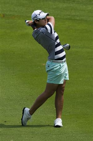 CHON BURI, THAILAND - FEBRUARY 19:  Tseng Yani of USA plays her second shot on the 2nd hole during round two of the Honda LPGA Thailand at the Siam Country Club on February 19, 2010 in Chon Buri, Thailand.  (Photo by Victor Fraile/Getty Images)