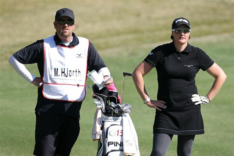 SHIMA, JAPAN - NOVEMBER 05:  Maria Hjorth of Sweden stands next to her caddie on the 18th hole during the round one of the Mizuno Classic at Kintetsu Kashikojima Country Club on November 5, 2010 in Shima, Mie, Japan.  (Photo by Kiyoshi Ota/Getty Images)