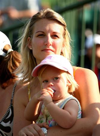 SUN CITY, SOUTH AFRICA - DECEMBER 07:  Emma Stenson wife of Henrik and daughter Lisa watch on during the final round of the Nedbank Golf Challenge at the Gary Player Country Club on December 7, 2008 in Sun City, South Africa.  (Photo by Richard Heathcote/Getty Images)