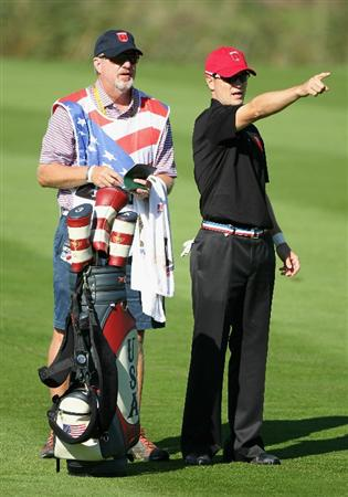 NEWPORT, WALES - OCTOBER 04:  Zach Johnson of the USA chats with his caddie Damon Green on the ninth hole in the singles matches during the 2010 Ryder Cup at the Celtic Manor Resort on October 4, 2010 in Newport, Wales.  (Photo by Andy Lyons/Getty Images)