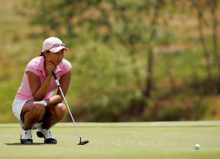 MORELIA, MEXICO - APRIL 28: Hana Kim of the United States lines up a putt on the third green during the third round of the Corona Championship April 28, 2007 at Tres Marias Club de Golf in Morelia, Michoacan, Mexico.  (Photo by Matthew Stockman/Getty Images)