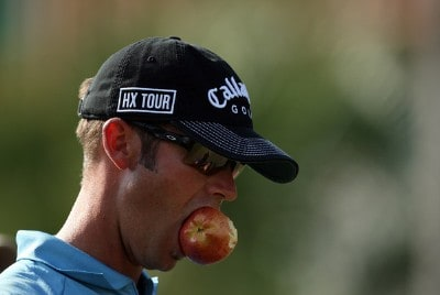 Rich Barcelo enjoys a snack on the tee at the first hole of the Palm Course during the second round of The Children's Miracle Network Classic held at The Disney Shades of Green Resort on November 2, 2007 in Orlando, Florida. PGA TOUR - 2007 Children's Miracle Network Classic presented by Wal-Mart - Second RoundPhoto by David Cannon/WireImage.com