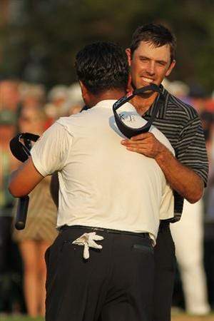 AUGUSTA, GA - APRIL 10:  Charl Schwartzel of South Africa (R) shakes hands with K.J. Choi of South Africa on the 18th green after Schwartzel's two-stroke victory at the 2011 Masters Tournament at Augusta National Golf Club on April 10, 2011 in Augusta, Georgia.  (Photo by Jamie Squire/Getty Images)