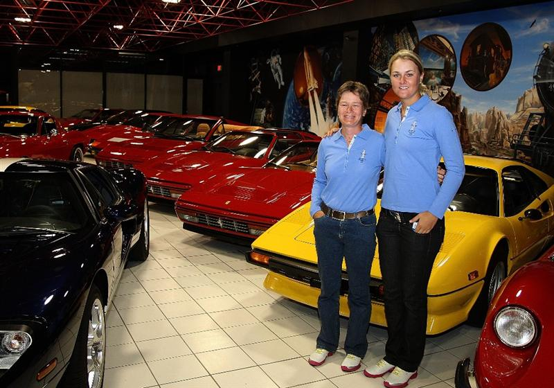 SUGAR GROVE, IL - AUGUST 17:  Catriona Matthew and Anna Nordqvist of the European Solheim Cup team pose inside the car museum on the grounds of Rich Harvest Farms, host site of the 2009 Solheim Cup on August 17, 2009 in Sugar Grove, Illinois.  (Photo by David Cannon/Getty Images)