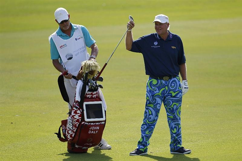 PLAYA DEL CARMEN, MEXICO - FEBRUARY 24:  John Daly pulls a club from his golf bag during the first round of the Mayakoba Golf Classic at Riviera Maya-Cancun held at El Camaleon Golf Club on February 24, 2011 in Playa del Carmen, Mexico.  (Photo by Michael Cohen/Getty Images)