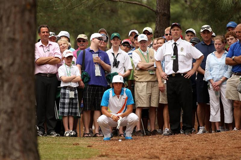AUGUSTA, GA - APRIL 08:  Rickie Fowler evaluates his shot from the rough on the 11th hole during the second round of the 2011 Masters Tournament at Augusta National Golf Club on April 8, 2011 in Augusta, Georgia.  (Photo by Andrew Redington/Getty Images)