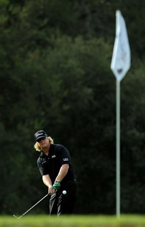 PACIFIC PALISADES, CA - FEBRUARY 04:  Charley Hoffman hits a pitch shot to the 12th green during the first round of the Northern Trust Open at Riviera Country Club on February 4, 2010 in Pacific Palisades, California.  (Photo by Jeff Gross/Getty Images)