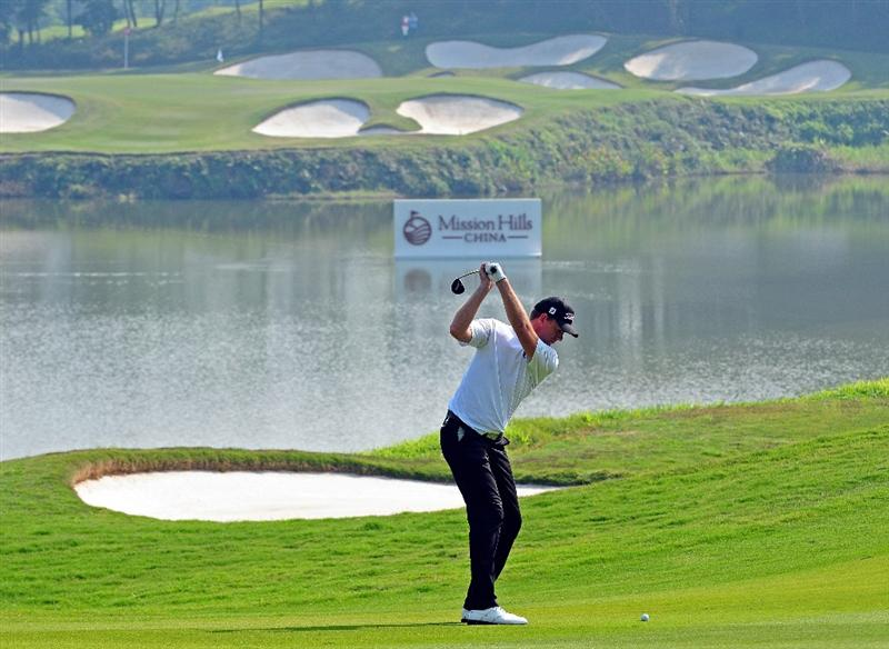 SHENZHEN, GUANGDONG - NOVEMBER 25: Robert Karlsson of Sweden plays a shot during pro - am the Omega Mission Hills World Cup on the Olazabal course on November 25, 2009 in Shenzhen, China. (Photo by Stuart Franklin/Getty Images)
