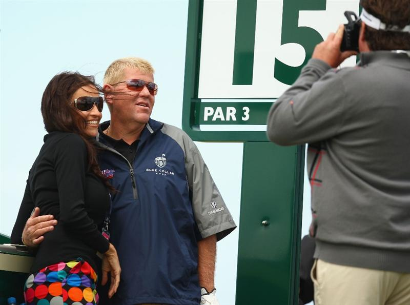 TURNBERRY, SCOTLAND - JULY 14:  John Daly of USA poses for a photo with a female companion during a practice round prior to the 138th Open Championship on the Ailsa Course, Turnberry Golf Club on July 14, 2009 in Turnberry, Scotland.  (Photo by Richard Heathcote/Getty Images)