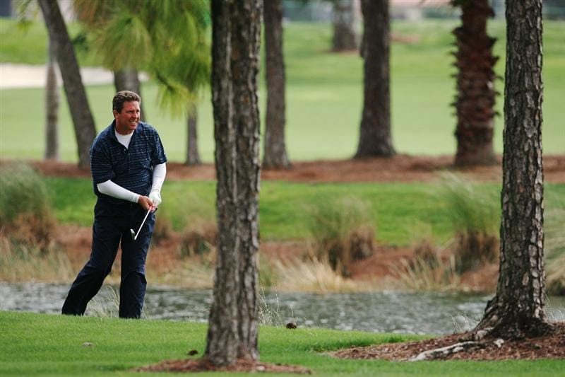 PALM BEACH GARDENS, FL - MARCH 03:  Hall-of-Fame NFL quarterback Dan Marino of the Miami Dolphins follows his approach shot out of the rough on the first hole during the Honda Classic Kenny G Gold Pro-Am at PGA National Resort And Spa on March 3, 2010 in Palm Beach Gardens, Florida.  (Photo by Doug Benc/Getty Images)