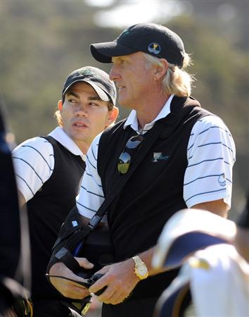 SAN FRANCISCO - OCTOBER 07:  International Team Captain Greg Norman (R) and Camilo Villegas stand  on the green during a practice round prior to the start of The Presidents Cup at Harding Park Golf Course on October 7, 2009 in San Francisco, California.  (Photo by Harry How/Getty Images)