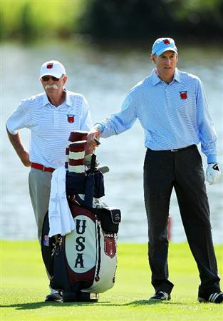 NEWPORT, WALES - SEPTEMBER 28:  Jim Furyk of the USA pulls a club as his caddie Mike Cowan looks on during a practice round prior to the 2010 Ryder Cup at the Celtic Manor Resort on September 28, 2010 in Newport, Wales.  (Photo by Andy Lyons/Getty Images)