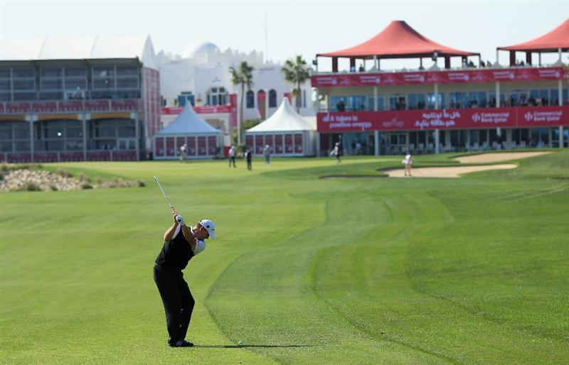 DOHA, QATAR - FEBRUARY 04:  Paul Lawrie of Scotland hits his second shot on the 18th hole during the second round of the Commercialbank Qatar Masters held at Doha Golf Club on February 4, 2011 in Doha, Qatar.  (Photo by Andrew Redington/Getty Images)