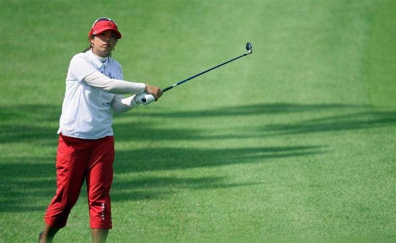 SINGAPORE - MARCH 06:  Shanshan Feng of China plays an approach shot during the second round of HSBC Women's Champions at the Tanah Merah Country Club on March 6, 2009 in Singapore.  (Photo by Ross Kinnaird/Getty Images)