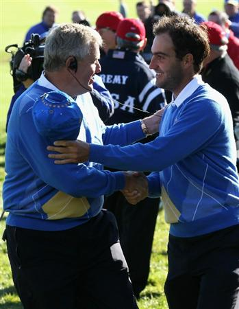 NEWPORT, WALES - OCTOBER 04:  The European Team Captain Colin Montgomerie encourages Edoardo Molinari in the singles matches during the 2010 Ryder Cup at the Celtic Manor Resort on October 4, 2010 in Newport, Wales.  (Photo by David Cannon/Getty Images)