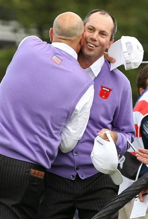 NEWPORT, WALES - OCTOBER 02:  Stewart Cink (L) of the USA is hugged by Matt Kuchar on the 18th green during the rescheduled Afternoon Foursome Matches during the 2010 Ryder Cup at the Celtic Manor Resort on October 2, 2010 in Newport, Wales.  (Photo by Ross Kinnaird/Getty Images)