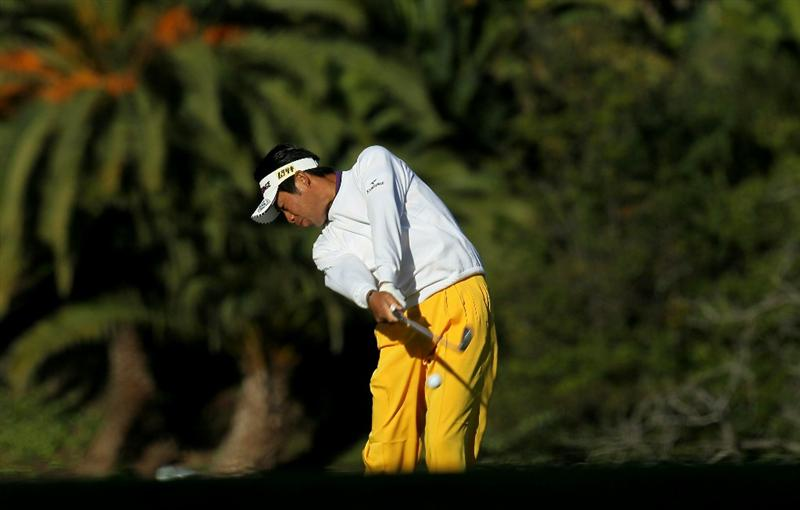 PACIFIC PALISADES, CA - FEBRUARY 17:  Yuta Ikeda of Japan hits his second shot on the first hole during round one of the Northern Trust Open at Riviera Counrty Club on February 17, 2011 in Pacific Palisades, California.  (Photo by Stephen Dunn/Getty Images)