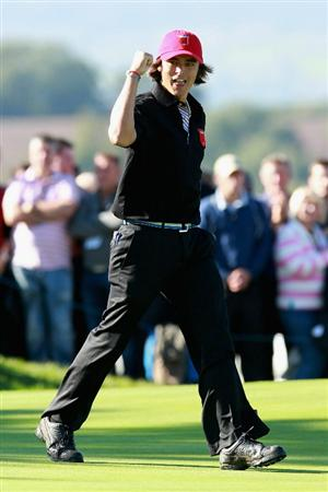 NEWPORT, WALES - OCTOBER 04:  Rickie Fowler of the USA celebrates on the 18th green after halving in the singles matches during the 2010 Ryder Cup at the Celtic Manor Resort on October 4, 2010 in Newport, Wales.  (Photo by Andrew Redington/Getty Images)