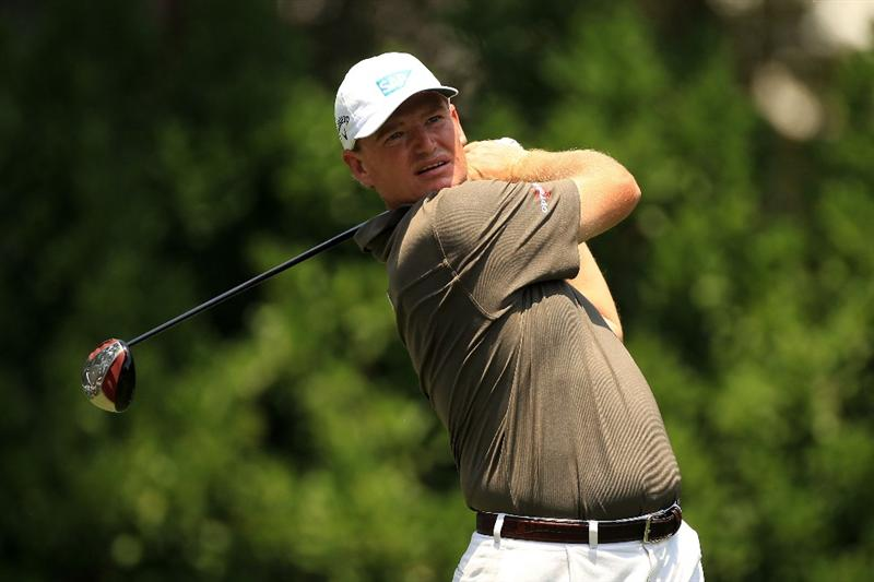 PONTE VEDRA BEACH, FL - MAY 13:  Ernie Els of South Africa hits his tee shot on the 11th hole during the second round of THE PLAYERS Championship held at THE PLAYERS Stadium course at TPC Sawgrass on May 13, 2011 in Ponte Vedra Beach, Florida.  (Photo by Streeter Lecka/Getty Images)