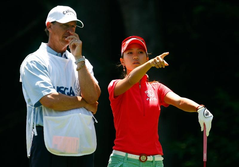 BETHLEHEM, PA - JULY 12:  Momoko Ueda of Japan chats with her caddie Terry McNamara on the ninth hole during the final round of the 2009 U.S. Women's Open at the Saucon Valley Country Club on July 12, 2009 in Bethlehem, Pennsylvania.  (Photo by Scott Halleran/Getty Images)
