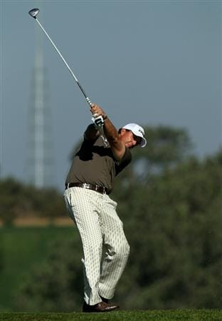 LA JOLLA, CA - JANUARY 29:  Phil Mickelson hits his tee shot on the fifth hole during round three of the Farmers Insurance Open at Torrey Pines South Course on January 29, 2011 in La Jolla, California.  (Photo by Stephen Dunn/Getty Images)