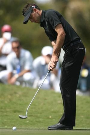 DORAL, FL - MARCH 14:  Charl Schwartzel of South Africa putting on the second hole during the final round of the 2010 WGC-CA Championship at the TPC Blue Monster at Doral on March 14, 2010 in Doral, Florida.  (Photo by Marc Serota/Getty Images)