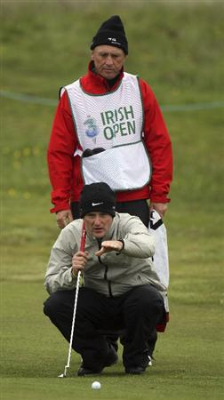 BALTRAY, IRELAND - MAY 14:  Marc Warren of Scotland is given some advice by his caddie John Graham on the 18th hole during the first round of The 3 Irish Open at County Louth Golf Club on May 14, 2009 in Baltray, Ireland.  (Photo by Ross Kinnaird/Getty Images)