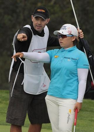 CITY OF INDUSTRY, CA - MARCH 27:  Jiyai Shin of South Korea chats with her caddie Shaun Clews on the 14th green during the final round of the Kia Classic on March 27, 2011 at the Industry Hills Golf Club in the City of Industry, California.  (Photo by Scott Halleran/Getty Images)
