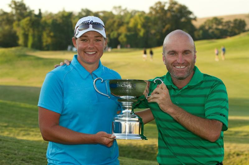 PRATTVILLE, AL - OCTOBER 10: Katherine Hull of Australia and caddie Vern Tess hold the champion's trophy following her victory at the Navistar LPGA Classic at the Senator Course at the Robert Trent Jones Golf Trail on October 10, 2010 in Prattville, Alabama. (Photo by Darren Carroll/Getty Images)