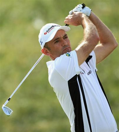 DOHA, QATAR - FEBRUARY 05:  Markus Brier of Austria hits his tee-shot on the eighth hole during the third round of the Commercialbank Qatar Masters held at Doha Golf Club on February 5, 2011 in Doha, Qatar.  (Photo by Andrew Redington/Getty Images)