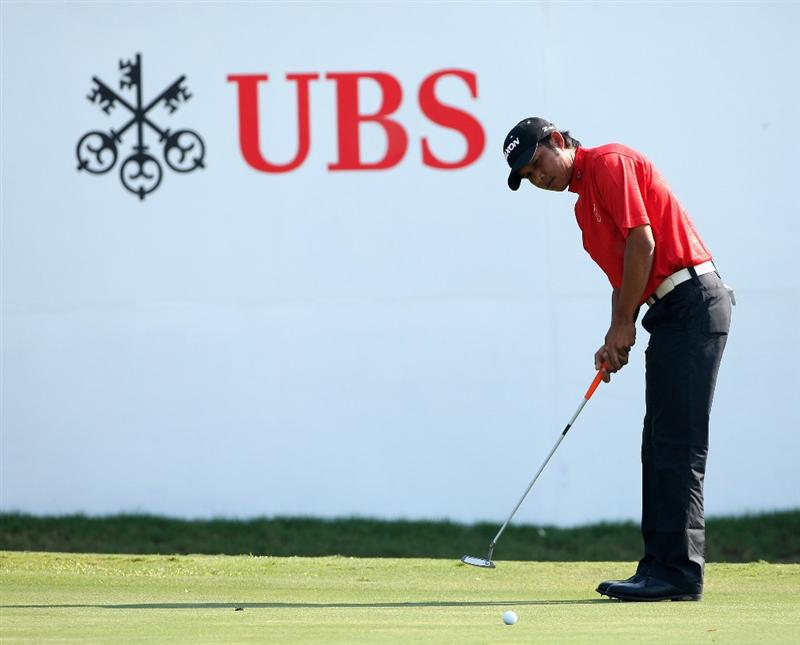 HONG KONG, CHINA - NOVEMBER 21:  Chawalit Plaphol of Thailand putting on the 18th hole during the second round of the UBS Hong Kong Open at the Hong Kong Golf Club on November 21, 2008 in Fanling, Hong Kong.  (Photo by Stuart Franklin/Getty Images)