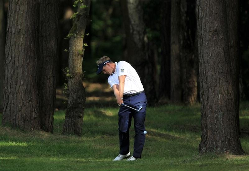 VIRGINIA WATER, ENGLAND - MAY 29:  Luke Donald of England hits his 2nd shot on the 12th hole during the final round of the BMW PGA Championship  at the Wentworth Club on May 29, 2011 in Virginia Water, England.  (Photo by David Cannon/Getty Images)