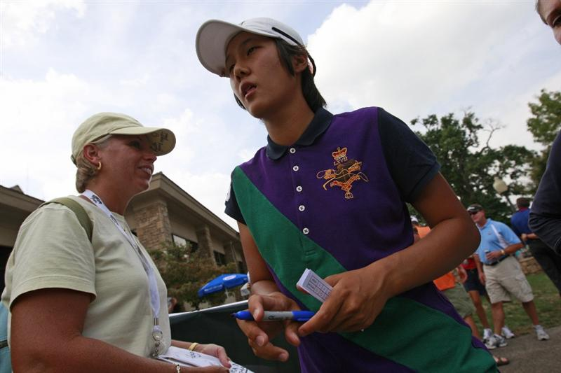 ROGERS, AR - SEPTEMBER 11:  Song-Hee Kim of South Korea signs autographs after completing her first round play in the P&G Beauty NW Arkansas Championship at the Pinnacle Country Club on September 11, 2009 in Rogers, Arkansas.  (Photo by Dave Martin/Getty Images)