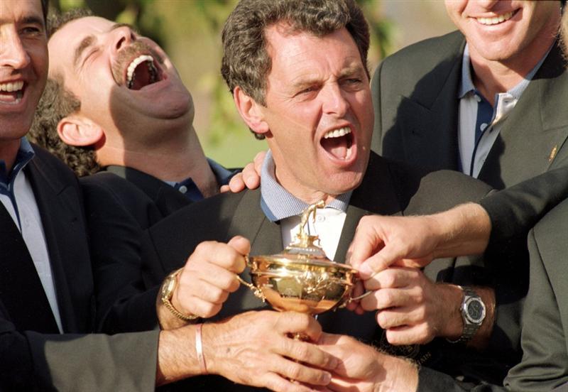 24 Sep 1995:  Joy for the European team as captain Bernard Gallacher and team member Sam Torrance get their hands on the trophy after victory in the Ryder Cup at Oak Hill Country Club in Rochester, New York, USA. \ Mandatory Credit: Stephen Munday /Allsport
