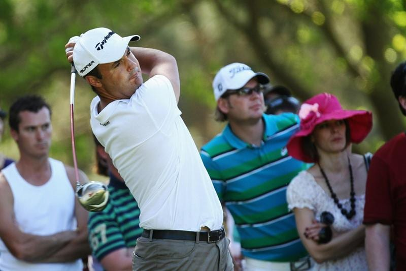 VIRGINIA WATER, ENGLAND - MAY 23:  Simon Khan of England plays an iron shot during the final round of the BMW PGA Championship on the West Course at Wentworth on May 23, 2010 in Virginia Water, England.  (Photo by Ross Kinnaird/Getty Images)