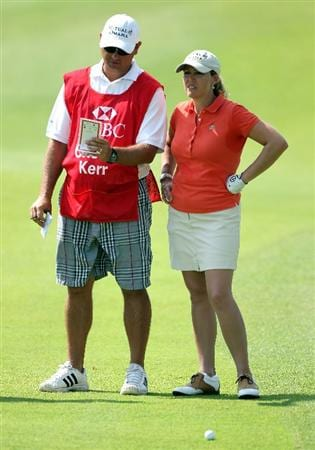 SINGAPORE - FEBRUARY 26:  Cristie Kerr of the USA waits with her caddie on the first hole during the second round of the HSBC Women's Champions at the Tanah Merah Country Club on February 26, 2010 in Singapore.  (Photo by Andrew Redington/Getty Images)