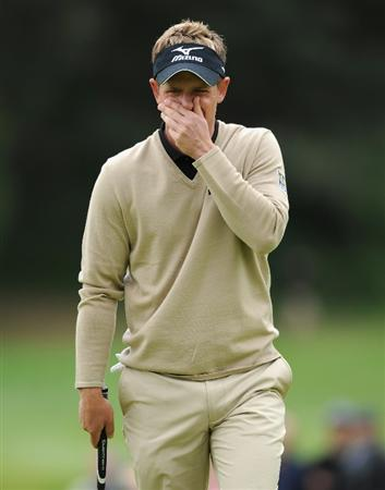 PACIFIC PALISADES, CA - FEBRUARY 18:  Luke Donald of England reacts to his putt on the 14th hole during the second round of the Northern Trust Open at Riviera Country Club on February 18, 2011 in Pacific Palisades, California.  (Photo by Stuart Franklin/Getty Images)