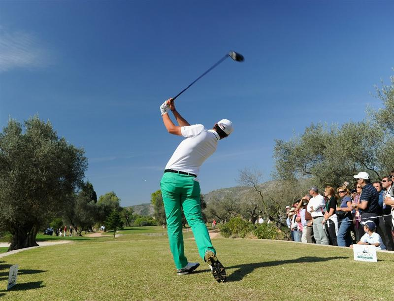 CASTELLON DE LA PLANA, SPAIN - OCTOBER 24:  Matteo Manassero of Italy plays his tee shot on the third hole during the final round of the Castello Masters Costa Azahar at the Club de Campo del Mediterraneo on October 24, 2010 in Castellon de la Plana, Spain.  (Photo by Stuart Franklin/Getty Images)