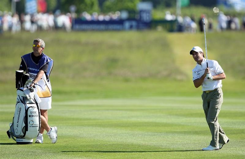 ASH, UNITED KINGDOM - MAY 31:  Steve Webster of England hits his second shot at the 16th hole during the final round of the 2009 European Open at the London Golf Club on May 31, 2009 in Ash, England  (Photo by David Cannon/Getty Images)