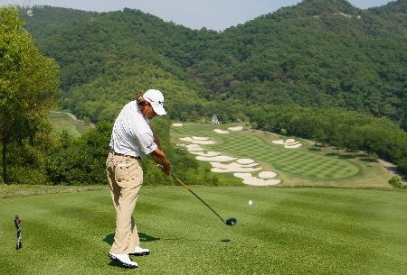 SHENZHEN, CHINA - NOVEMBER 24:  Alex Cejka of Germany plays his tee shot on the 10th hole during the third round of the Omega Mission Hills World Cup at the Mission Hills Golf Resort on November 24, 2007 in Shenzhen, China.  (Photo by Stuart Franklin/Getty Images)