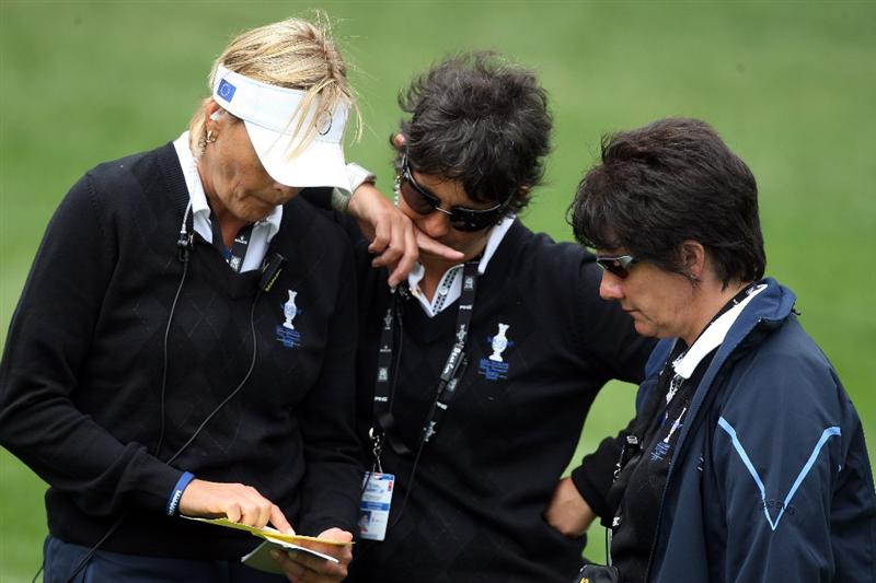 SUGAR GROVE, IL - AUGUST 21: Alison Nicholas of England the European Team Captain (centre) with her assistant captains Joanne Morley of England (right) and Liselotte Neumann of Sweden during the Friday morning fourball matches at the 2009 Solheim Cup Matches, at the Rich Harvest Farms Golf Club on August 21, 2009 in Sugar Grove, Ilinois  (Photo by David Cannon/Getty Images)