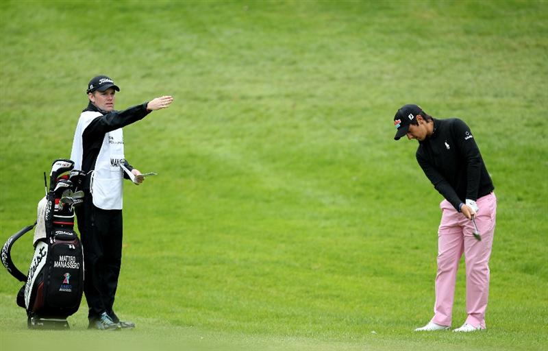 VIRGINIA WATER, ENGLAND - MAY 28:  Matteo Manassero of Italy and caddie Ryan McGuigan line up a shot on the 1st hole during the third round of the BMW PGA Championship at the Wentworth Club on May 28, 2011 in Virginia Water, England.  (Photo by Ian Walton/Getty Images)
