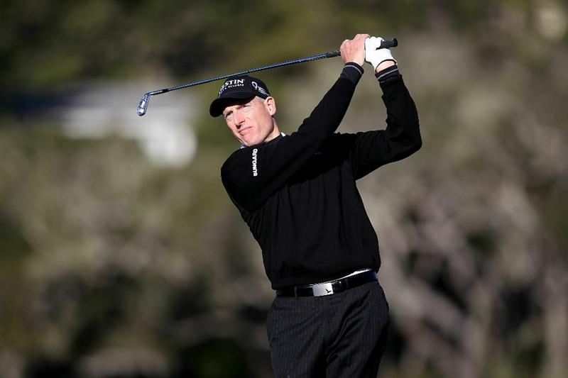 PEBBLE BEACH, CA - FEBRUARY 10:  Jim Furyk tees off during the first round of the AT&T Pebble Beach National Pro-Am at the Pebble Beach Golf Links on February 10, 2011 in Pebble Beach, California.  (Photo by Jed Jacobsohn/Getty Images)