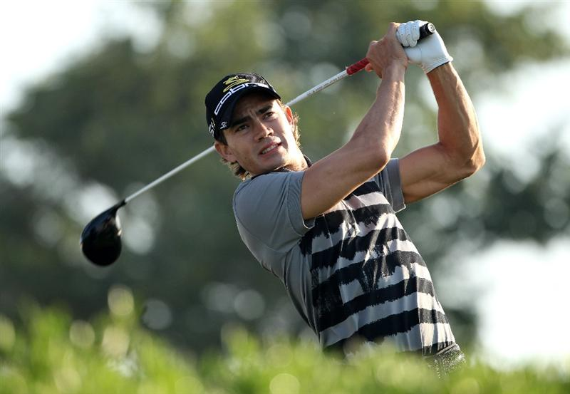 ABU DHABI, UNITED ARAB EMIRATES - JANUARY 22:  Camilo Villegas of Colombia hits his tee-shot on the 11th hole during the second round of The Abu Dhabi Golf Championship at Abu Dhabi Golf Club on January 22, 2010 in Abu Dhabi, United Arab Emirates.  (Photo by Andrew Redington/Getty Images)