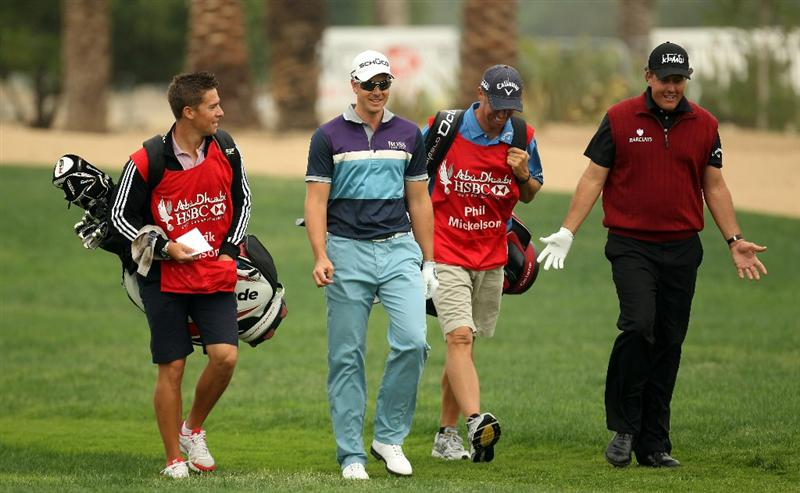 ABU DHABI, UNITED ARAB EMIRATES - JANUARY 22:  Henrik Stenson of Sweden chatting with Phil Mickelson of the USA during the third round of the Abu Dhabi HSBC Golf Championship at the Abu Dhabi Golf Club on January 22, 2011 in Abu Dhabi, United Arab Emirates.  (Photo by Ross Kinnaird/Getty Images)